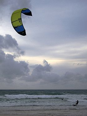 A large surfing kite in action