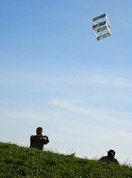 A traditional box kite in flight.