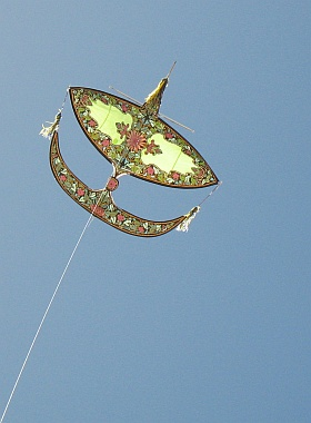 A large Wau Bulan in flight at the Adelaide Kite Festival.