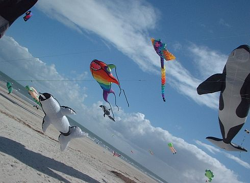 Some large inflatables hovering over the sand