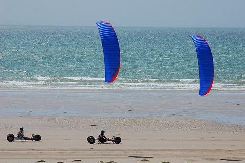 4-line traction kites pulling two 3-wheeler kite buggies.