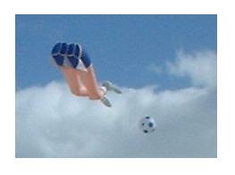 Humorous kicking legs kite.