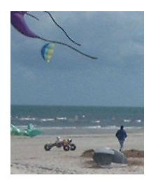 A kite buggy on the beach.