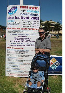 Adelaide Kite Festival 2008 - Tim Parish and Aren in front of official Festival sign.