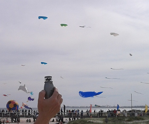 A retail wind meter in use at a kite festival.