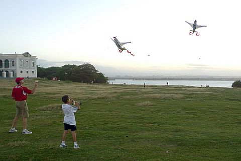 A couple of plane kites featuring corkscrew spinners for tails.
