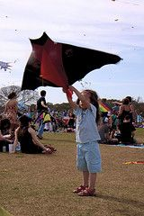 The Super Bat kite, being launched by a young helper.
