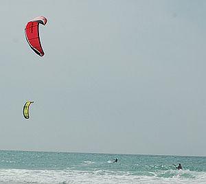 2 kite surfers in action at Haifa beach, in Israel.