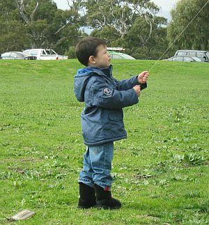 Child Flying Kite - Aren flying the Dowel Barn Door.