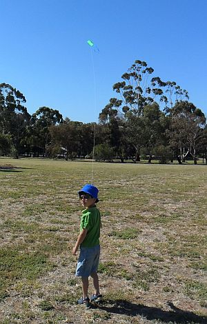 Child Flying Kite - Aren, nearly 6 now, back with the old Baby Sled.
