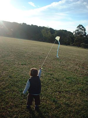 Child Flying Kite - Aren trotting downwind with small Diamond.n