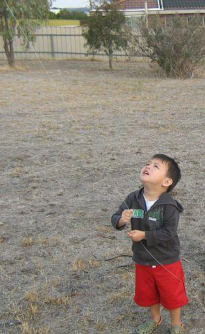 Child Flying Kite - Aren flying the Dowel Rokkaku.