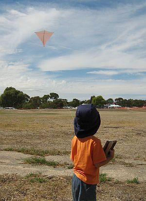 Child Flying Kite - Aren flying the Dowel Diamond.