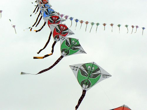 Trains of Diamond kites with Asian decoration and characters.