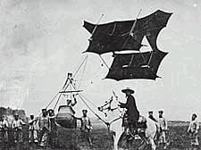 Cody kite in the air, with Cody himself on horseback