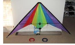 Stunt kite ready to fly. Spreader inserted and flying lines attached to bridle lines.