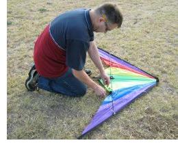 Out on the field, with the Delta stunt kite nearly ready to fly.