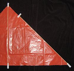 The Simple Delta - taping the spars to the sail - 1