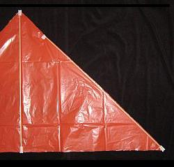 The Simple Delta - taping the spars to the sail - 2