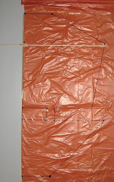 The 2-Skewer Dopero - template shape marked on plastic bag.
