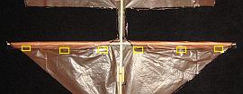 The 1-Skewer Roller - attaching the leading edge of the lower sail
