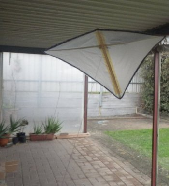 The MBK Indoor Diamond kite flying under a verandah.