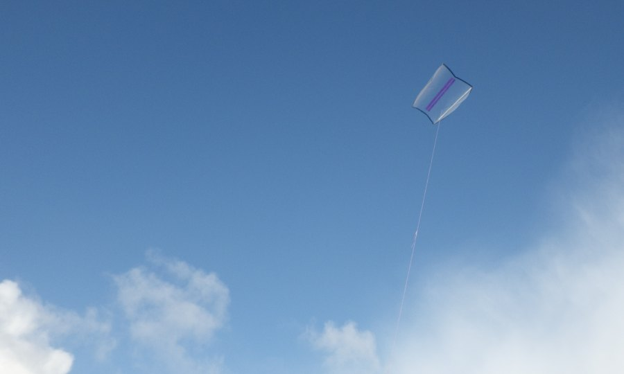 The MBK Indoor Sled kite flying over our side lawn.