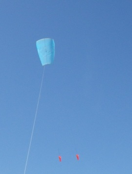 Multi-Dowel Sled kite in flight with twin drogues.