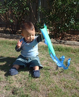 KIte Flying Stories - toddler Aren playing with the Baby Sled kite.
