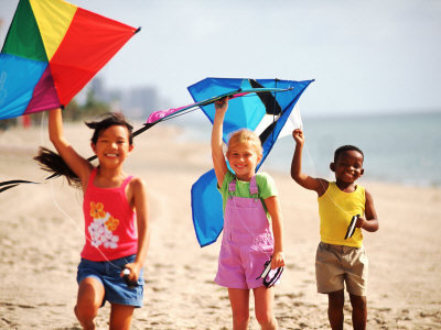 Kids on the beach with kites