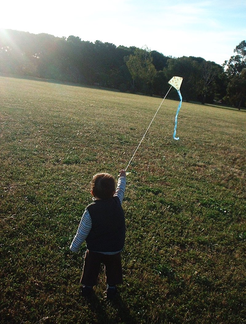 3-year-old Aren with an equally tiny home-made diamond kite.