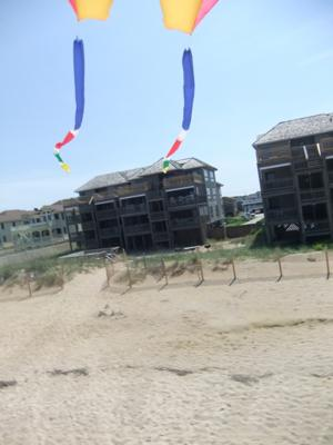 A view through my homemade tails to our condo on the beach.