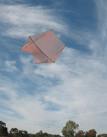 The MBK Dowel Rokkaku kite in flight on a sunny day.