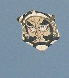 Rokkaku Kites - decorated with stern Asian face in sepia color scheme