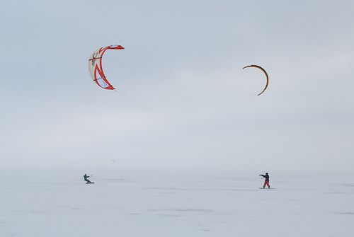 2 kite powered board riders.