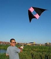 A delta conyne box kite being launched.