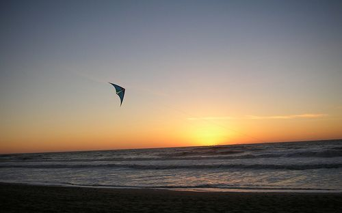 Peaceful sunset shot of a graceful Delta stunt kite.