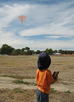 Child Flying Kite - Aren flying the Dowel Diamond.
