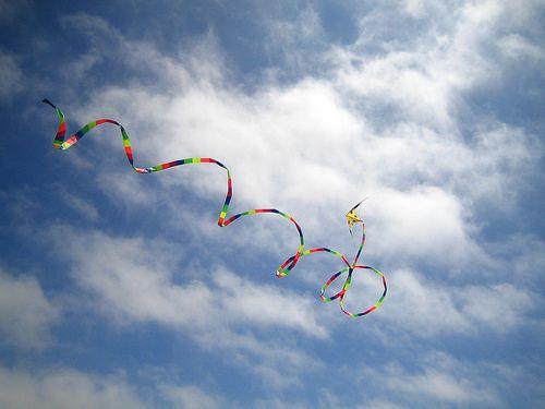 A Delta stunt kite being flown exuberantly!e