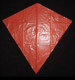 The Simple Diamond - the sail cut out and edged with tape.