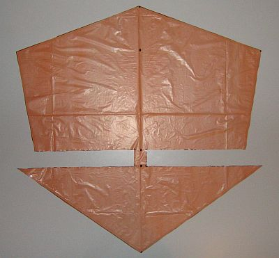 The 2-Skewer Roller - sail cut out and edged with sticky tape