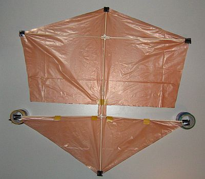 The 2-Skewer Roller - spars taped onto sail.
