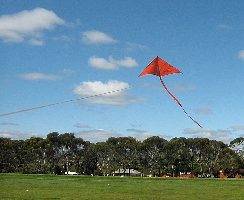 The Simple Delta kite climbing in a very light breeze.