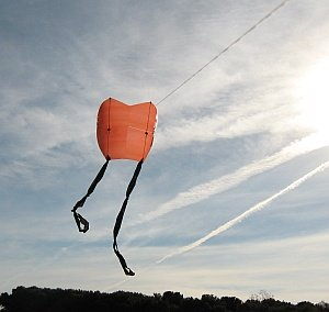 A home-made Sled kite with twin tails.