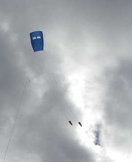 Fresh Wind Sled kite in flight with twin drogues.