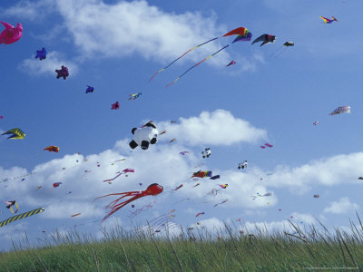The sky crowded with kites at a festival