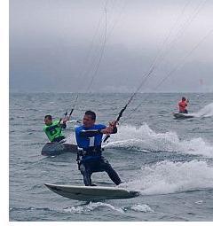 Kite Racing - 3 kite racers powering across the water.