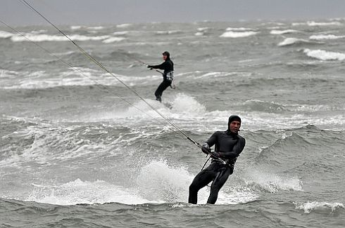 Two kite surfers in action