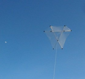 The MBK Barn Door Kite in flight next to the moon