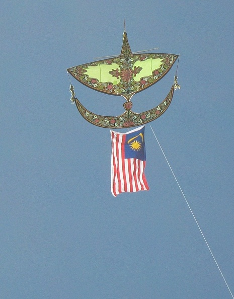 The Wau kite at Semaphore Beach, trailing a Malaysian flag.